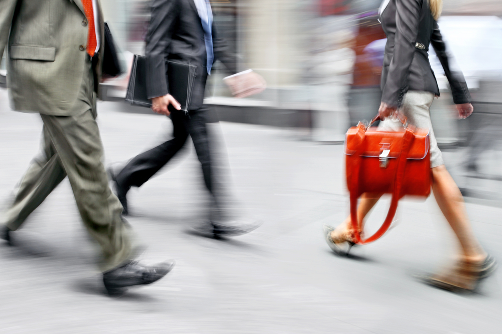 Business people on the go at rush hour
