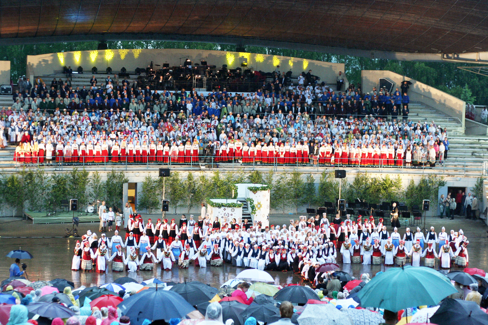 A huge choir sings on stage as part of the Estonian Song Festival.