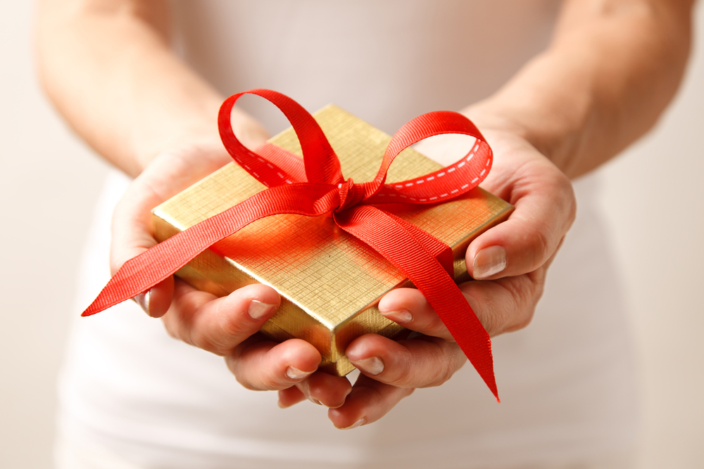 Gifts are given and received with both hands to indicate care and gratitude.