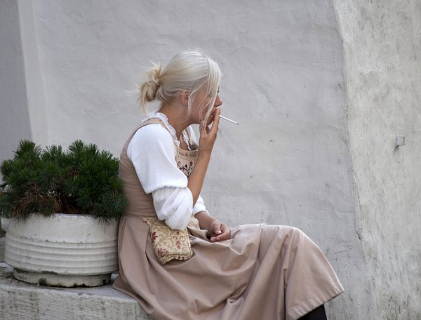 A woman takes a smoke break in Tallinn.
