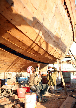 Craftsmen working on a dhow