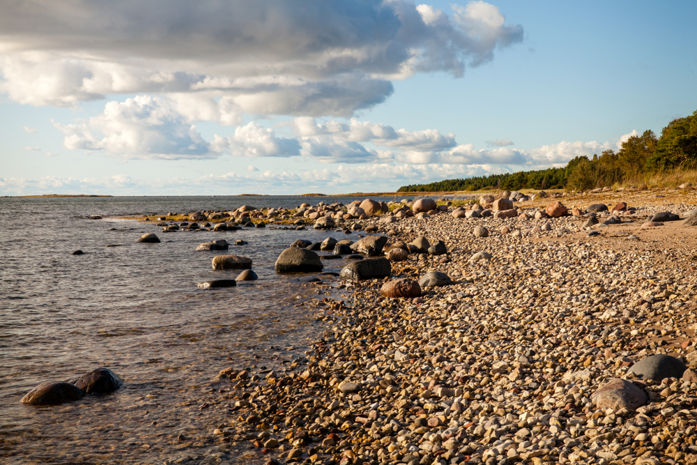 Matsi Beach on the Baltic Sea is an inviting spot for rock pickers on a sunny day. The Baltic coast experiences a warming influence from the Gulf Stream.