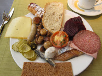 Breakfast in Estonia is usually composed of bread, cold meat, and cheese.
