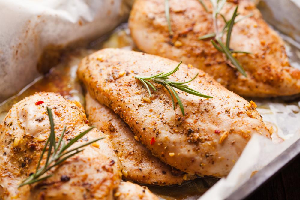 Baked Chicken, Shown With Rosemary Garnish