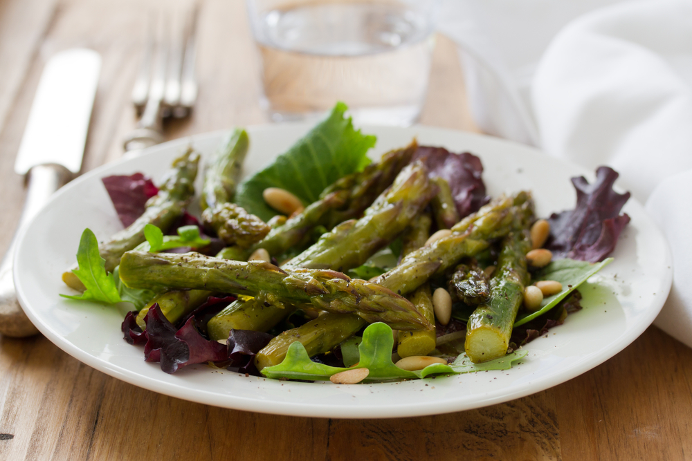Chilled Asparagus Salad, Shown Over Lettuce and With Pine Nuts