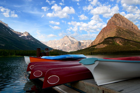 Canoes for hire on an alpine lake